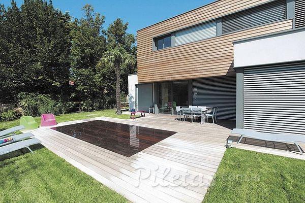 Tendencias la piscina con suelo m vil for Pileta piscina